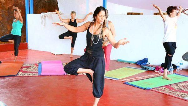 vinyasa flow teacher with treepose or vrkshasana, yttc goa
