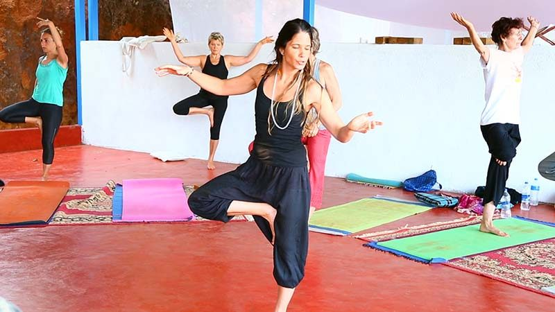 vinyasa flow teacher with treepose or vrkshasana, yttc goa