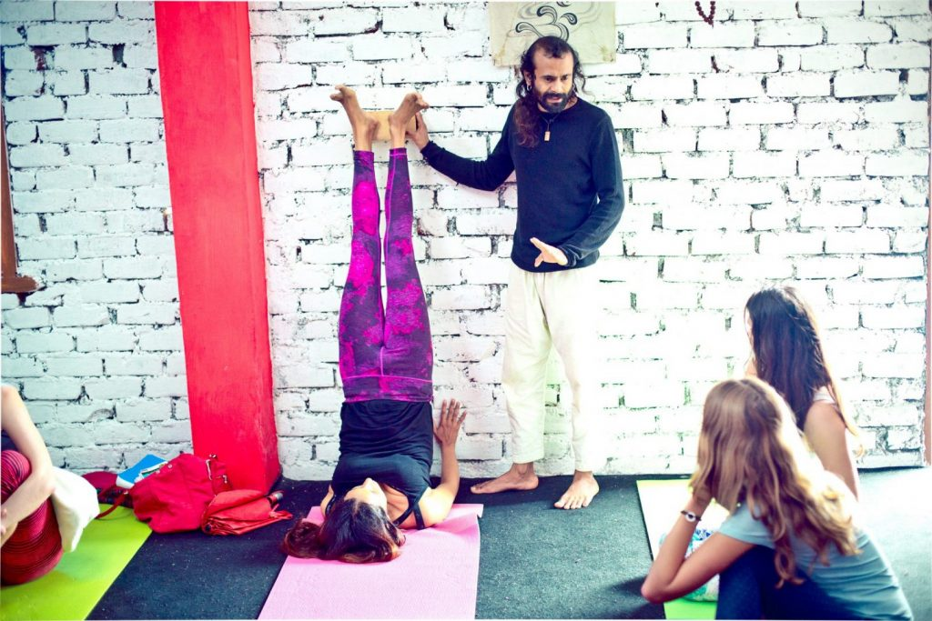 Art of teaching showing shoulderstand with wall support