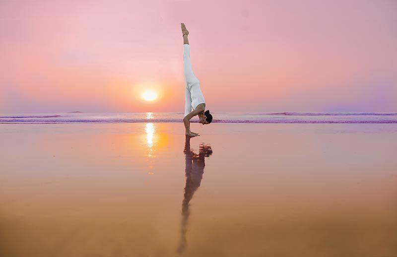 eka pada uttananasana, Standing Split, Urdhva Prasarita Eka Padasana, at the beach in goa, india, yoga teacher training in shreehari yoga school