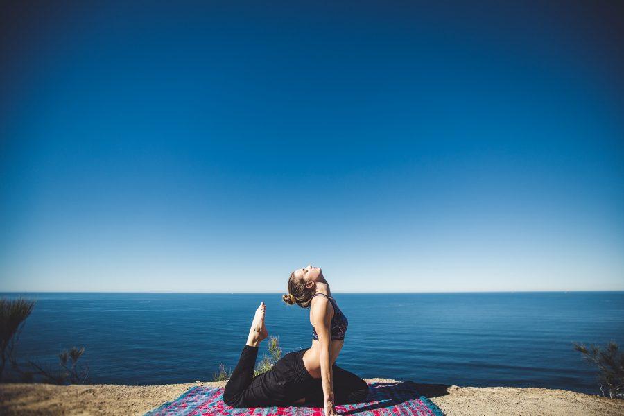 Shree hari yoga Yoga student practising on the beach