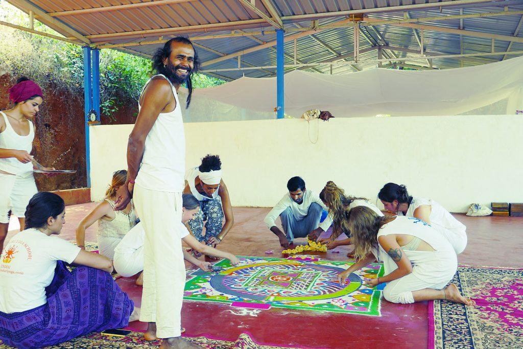 hari pawali owner shree hari yoga with students creating mandala in the yoga school in Gokarna, yoga teacher training in india