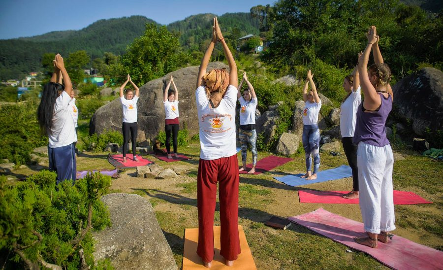Sun salutation hatha yoga at shree hari yoga school in dharamsala, india