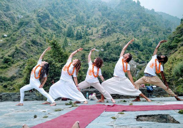 warrior posing in the himalayas from shree hari yoga students in rishikesh