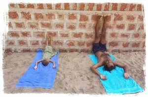 Legs up the wall pose Viparita-karani-yoga pose with child